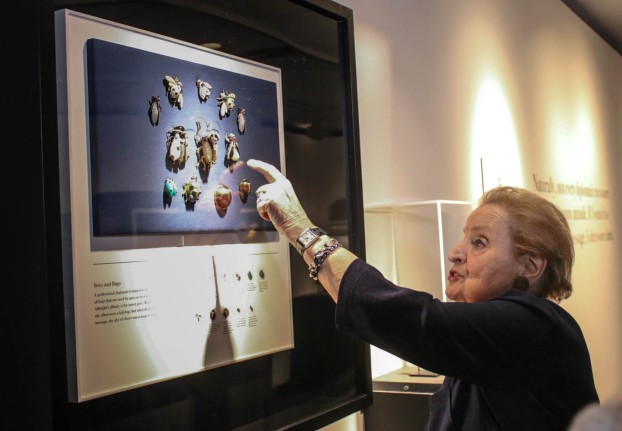 Secretary Albright noting a few of her past pins.